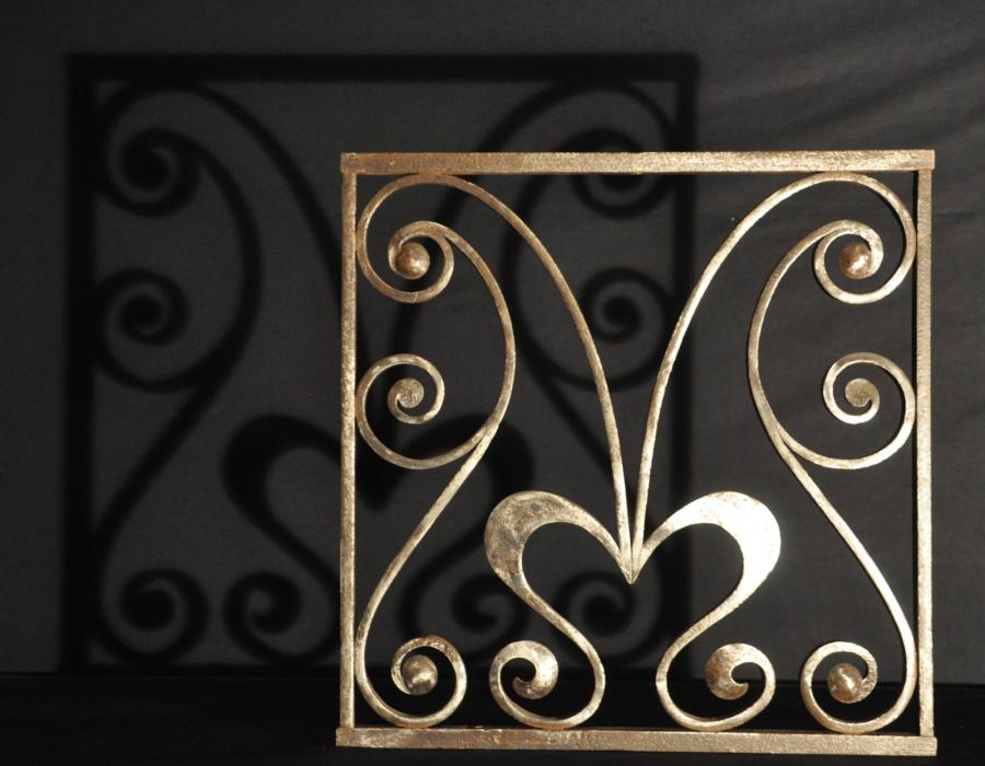 A  pair of art nouveau antique wrought iron grills or panels