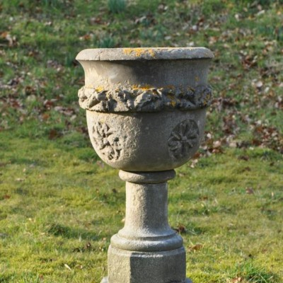 A  19th century antique carved stone urn font