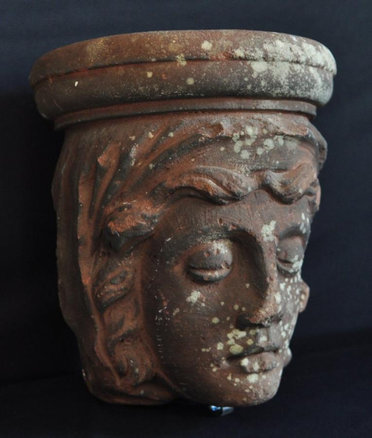 antique architectural carved stone head