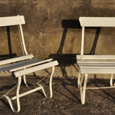 Four matching antique iron and wood garden chairs