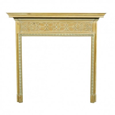 An Edwardian pine and gesso fire surround