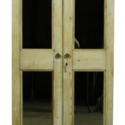 A Pair of pine cupboard doors fitted with mirror panels