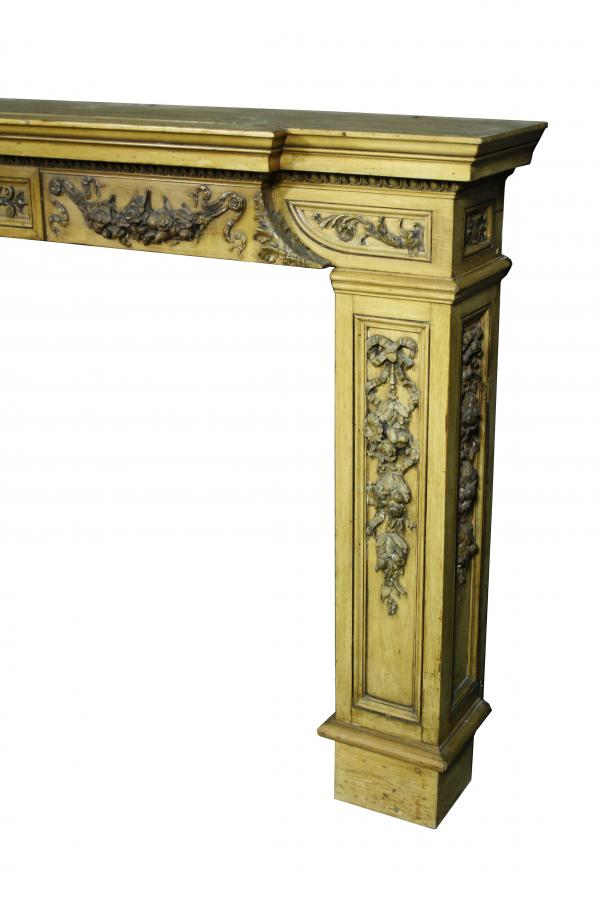 A large Edwardian pine and gesso fire surround