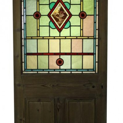 A stripped pine stained glass door