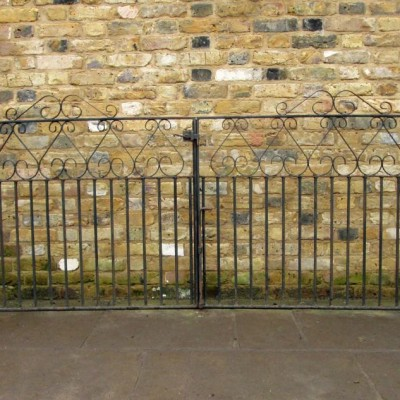 A Pair Of Reclaimed Inverse Heart Design Gates