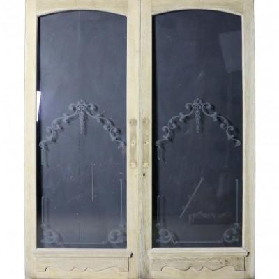 A pair of exterior glazed oak shop doors