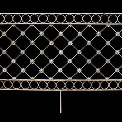 A wrought iron railing section / headboard