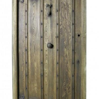 A 1920's oak front door with frame and door furniture