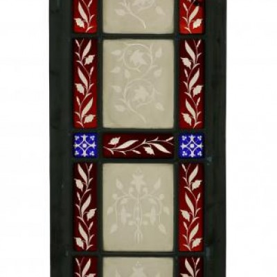 A pair of antique stained and etched glass windows