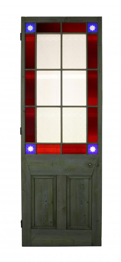 A Victorian stained glass door with cut glass corners