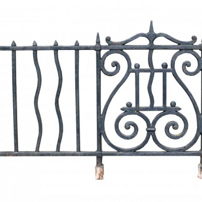 A 21 meter run of antique cast iron wall top railings