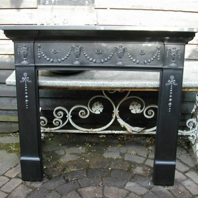 Original cast iron fireplace surround.