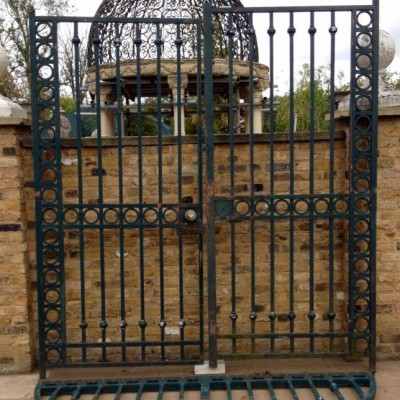 A Very Large Pair Of Reclaimed Wrought Iron Gates