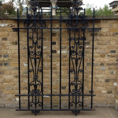 A Set Of Ornate Wrought Iron Railings
