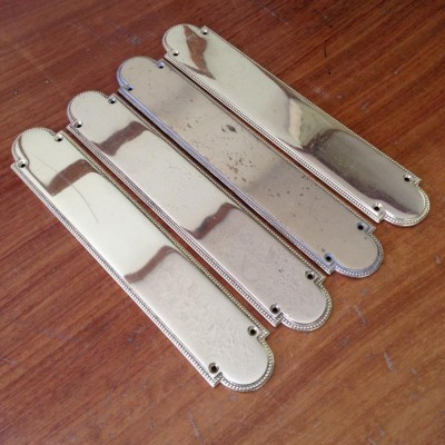 Three Pairs Of Brass Finger Plates