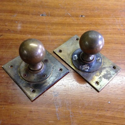 A PaIr Of Brass Door Knobs
