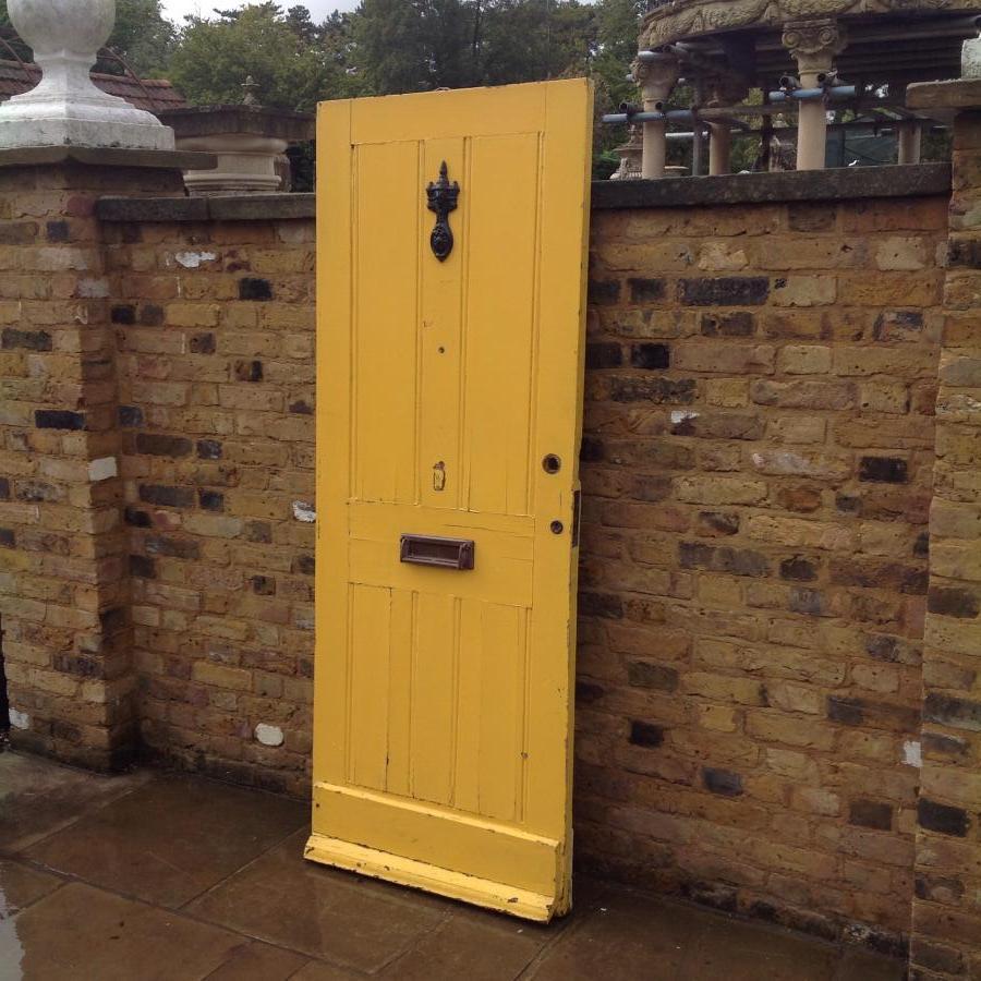 A Yellow Reclaimed Hardwoord Front Door