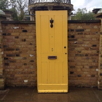 A Yellow Reclaimed Hardwoord Front Door