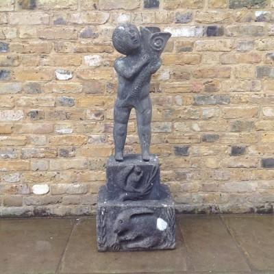 A Reclaimed Stone Garden Statue