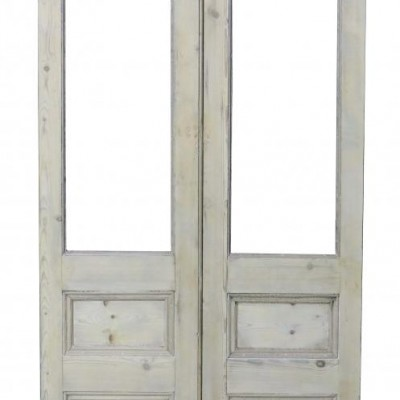 A pair of antique stripped pine French doors
