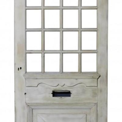 An antique stripped pine front door