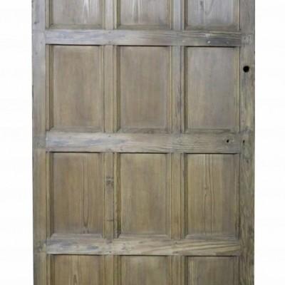 An antique arched Hemlock / Pine door