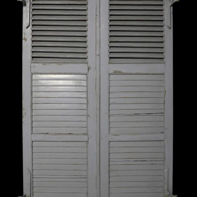 A pair of antique French painted Louvre shutters