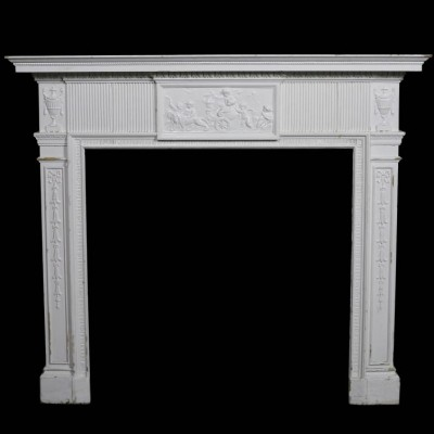 A painted 19th Century pine and composition fire surround