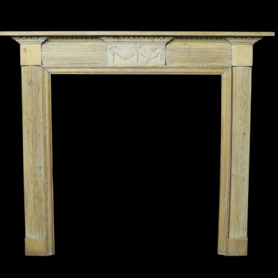 A 19th Century carved pine fire surround
