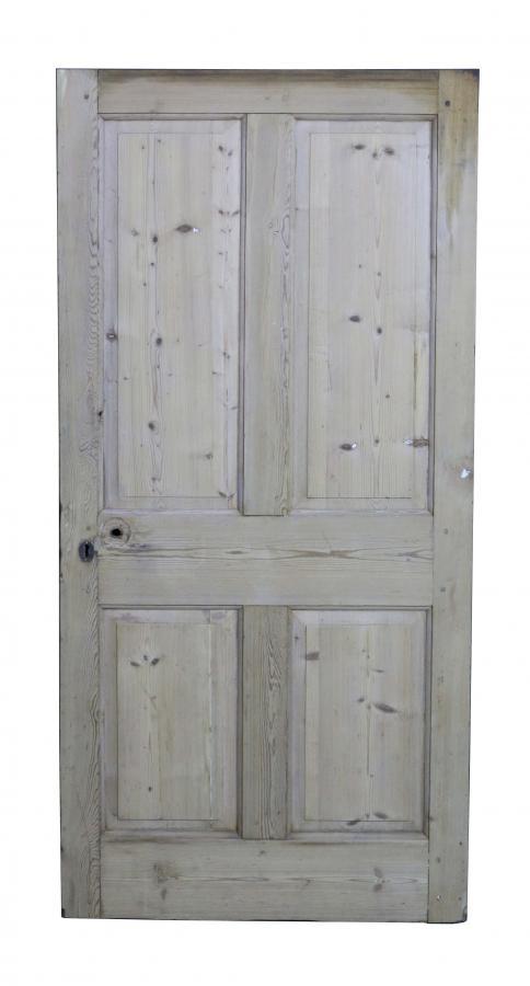 A four panel stripped pine internal door