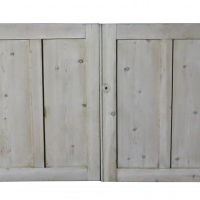 A pair of antique stripped pine cupboard doors