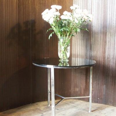 an art deco glass and metal circular table
