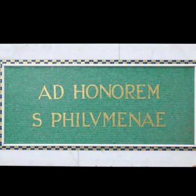 A marble and mosaic tile plaque honouring Saint Philomena
