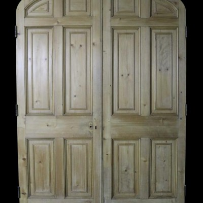 A pair of reclaimed stripped pine arched internal doors