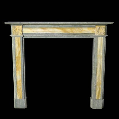 An early 20th C. Swedish Green and Sienna marble fire surround