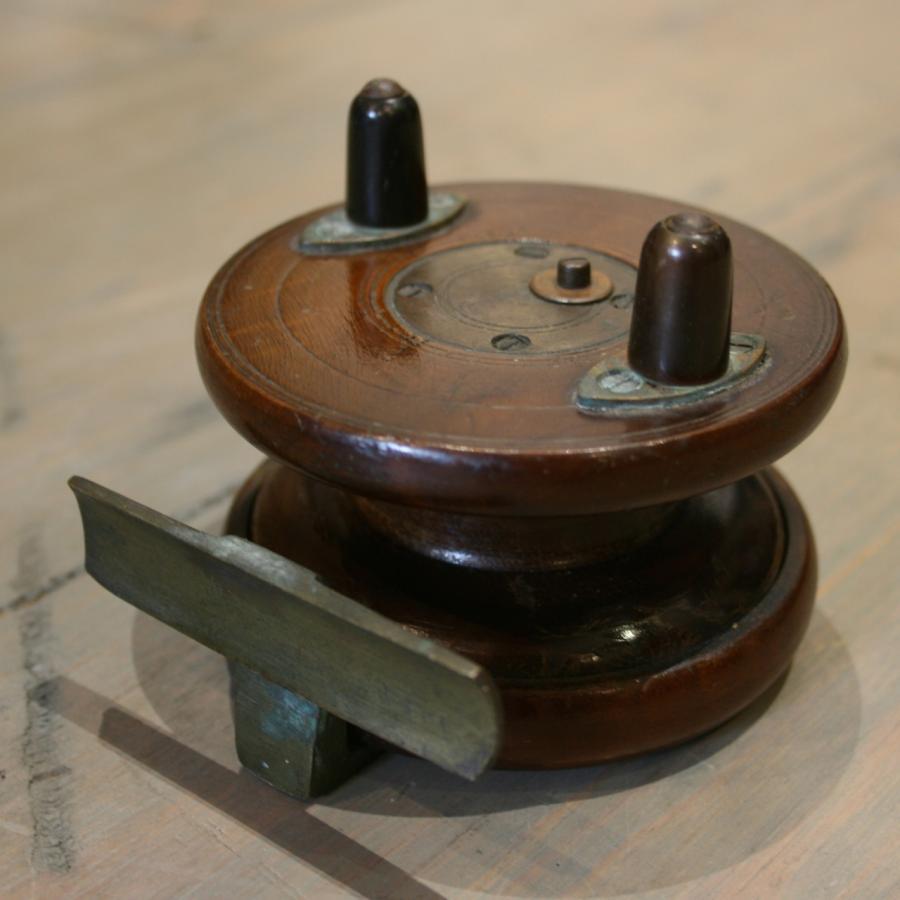 Vintage mahogany fishing reel