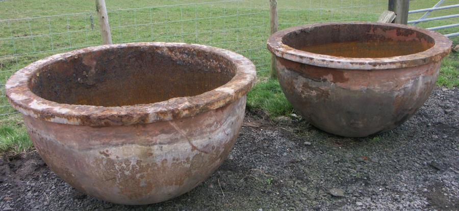 pair of very large cast iron vessels troughs