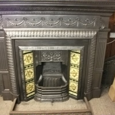 impressive cast iron surround and insert