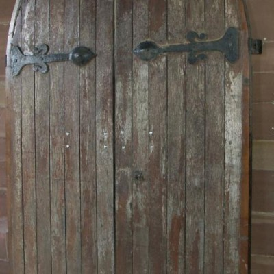 Antique arched oak church doors