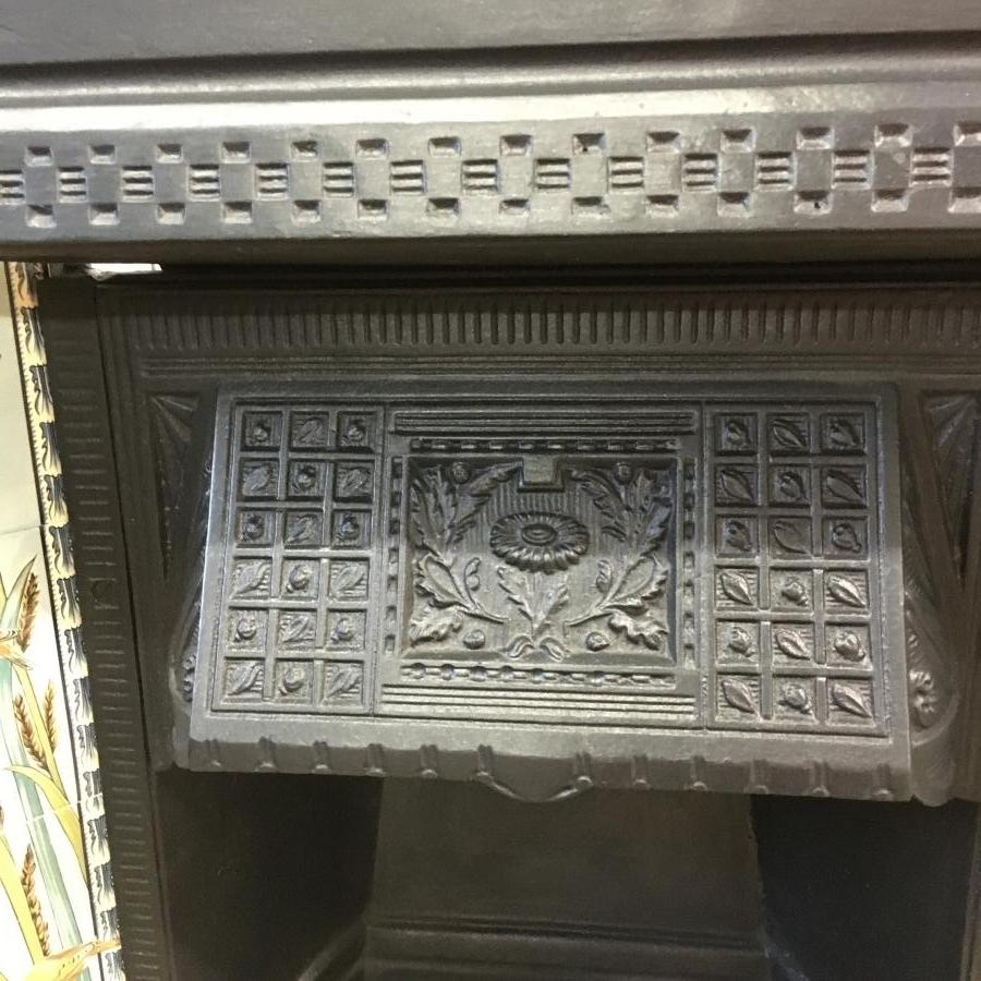 Reclaimed cast iron tiled insert