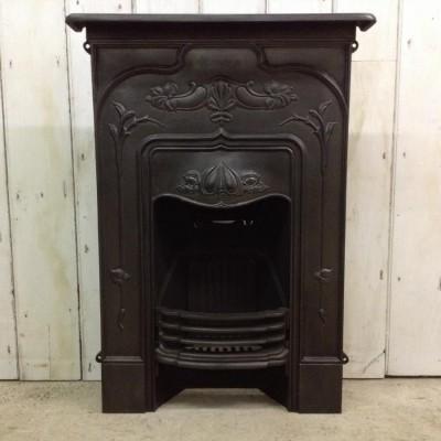 A reclaimed Art Nouveau fireplace