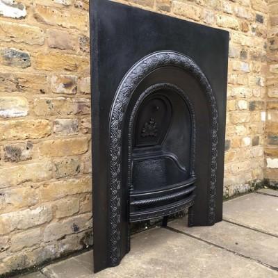 A vintage Victorian cast iron fire