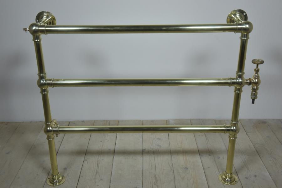 Large scale antique brass heated towel rail