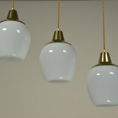 8 gold capped opaline pendant lights