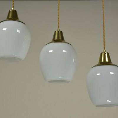 8 gold capped opaline pendant lights
