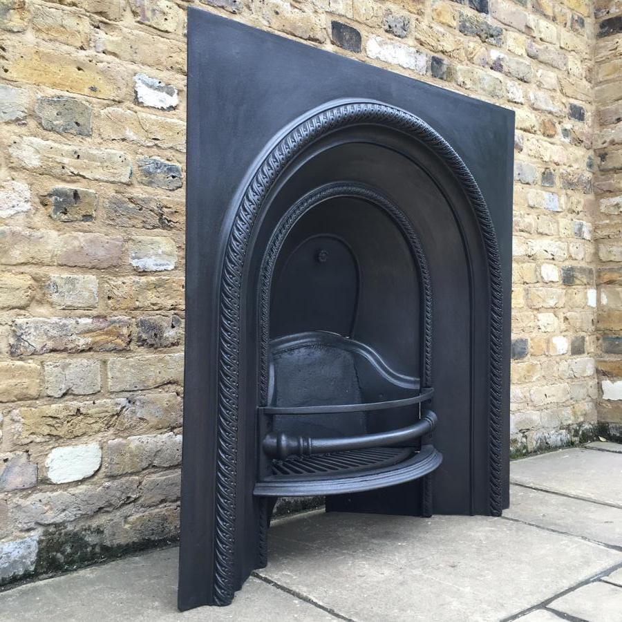 A Victorian cast iron fireplace