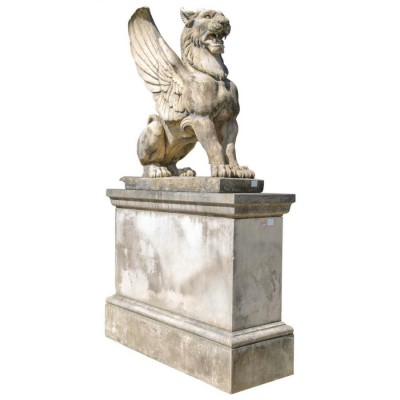 A Pair of Large Winged Lions on their own Plinths