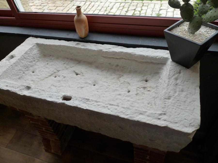 antique stone sink on brick supports