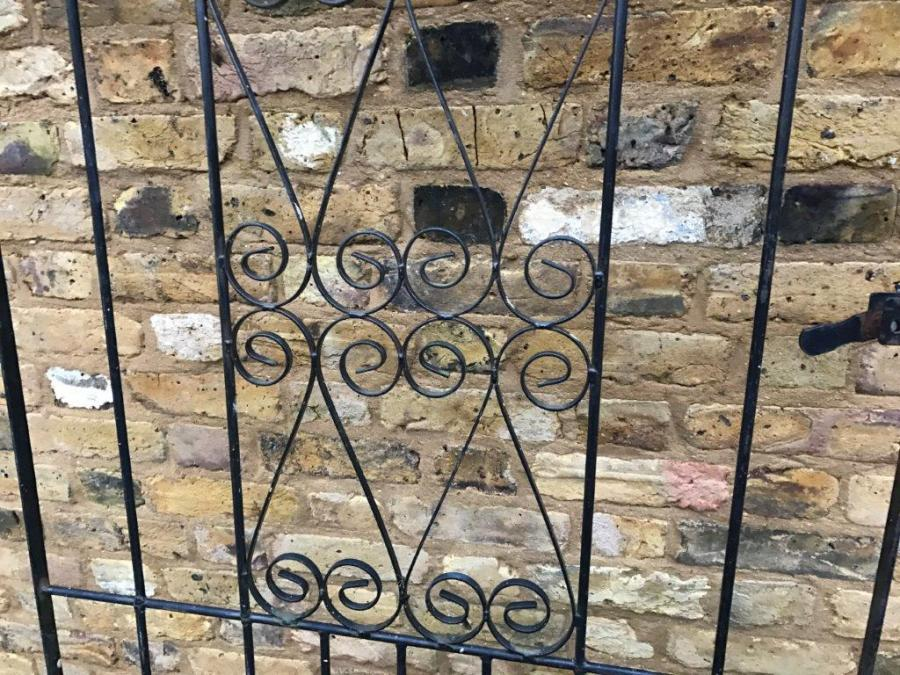 Round-Topped Wrought Iron Gate with Straight and Swirl Pattern