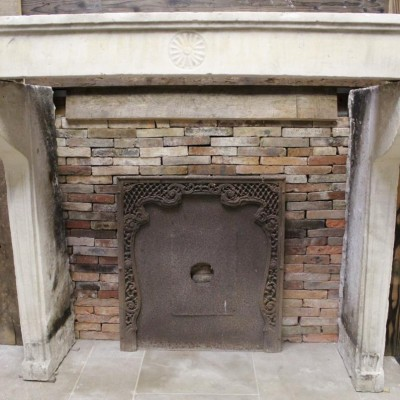 Antique French Limestone fireplace in Louis XVI style
